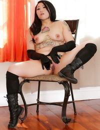 Solo Asian stunner posing in black footwear and suspenders plus gloves
