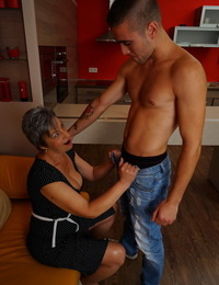 Nasty granny smooches her boy toy before they get around to pounding
