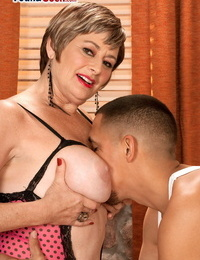 Older woman with short hair helps a youthfull gifted with his cock problems