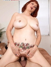 Older redhead Angie Summers has sex on a Murphy sofa with her young paramour