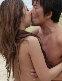 Japanese damsel Yui Nanase slides off swimsuit to fuck her dude on a sandy beach