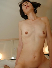 Slippy asian MILF with lil\' knockers gets her hairy vagina pounded and creampied