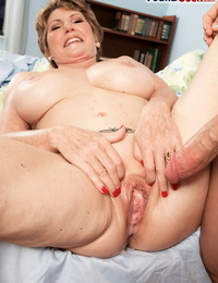 Brief haired granny Bea Cummins pounds a young guy while her husband sees