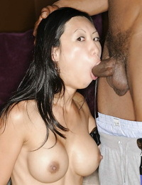 Busty asian Mummy gives a slurpy deep throat on a fat captured man-meat