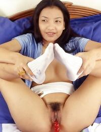 Fabulous asian stunner in white socks jerking her pubic hair with various toys