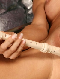 Amateur model rams a recorder up her m2m vagina while posing bare