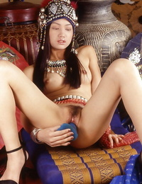 Horny asian babe demonstrating off her sexy curves and toying her S/M slit