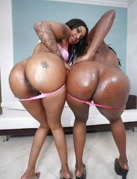 Ebony Mummy babes Capri and Stacy posing together to show huge booties