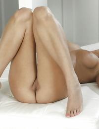 European solo girl Lia Taylor uncovering big pornstar tits and shaved vagina