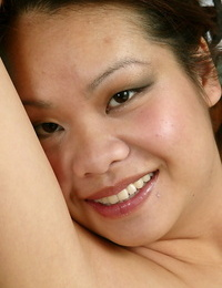 Smiley asian amateur with hairy gash leisurely revealing her genitals