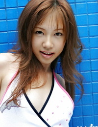 Small asian stunner Reika Shina stripping and spreading her gams