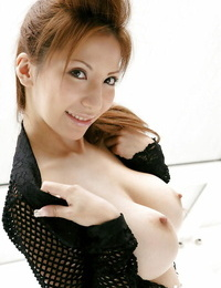 Provocative asian babe on high high-heeled slippers unveiling her amazing big hooters