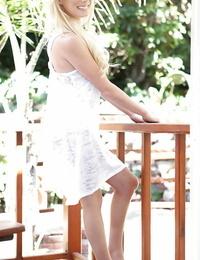 Juicy teenage light-haired Elaina Raye undressing off her sundress and bikini