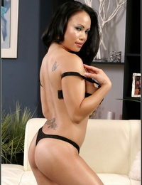 Asian babe Mya Luanna undresses knockers and ass from black lace lingerie