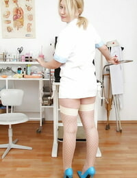 Lusty nurse taking off her undies and playing with a buttplug