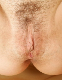 Graceful brown-haired amateur posing bare and taunting her hairy pussy