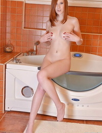 Redhead babe Linda Sweet is huge-titted her frigs in the bathroom