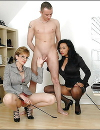 Lusty mature femdoms on high high-heeled slippers tormenting a engorged hard-on