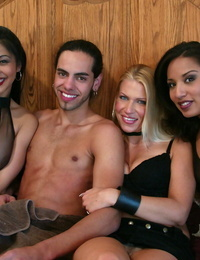3 fine females hold a dude down and take turns pegging his cherry arse