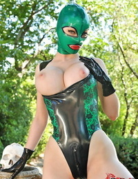 Molten fetish vixen in spandex mask and suit exposing her knockers and honey pot