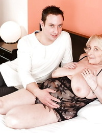 Blond granny with big saggy hooters taking jizz shot from junior stud after bj