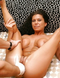 Mummy Cintia Silver with big hooters is into fisting with sexy Petra M.