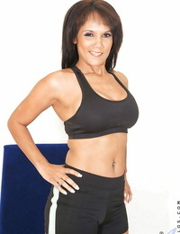 Fit middle aged lady Anjanette doffing sports bra and cut-offs to stance naked