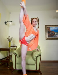 Adorable redhead shows off her flexible teenager bod in ponytails