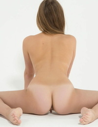 Super fexible Kira contorts her slim nude body showing closeup clean-shaven cunt