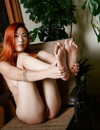Barefoot Asian inexperienced Lea Hart slides subjugation aside to expose hairless cunt