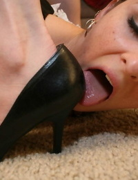 Willing femdom victims in sole fetish worship of footwear and high high-heeled slippers
