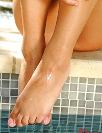 European blonde stunner with sexy gams in the poolside foot fetish scene.