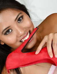 Asian in crimson high high-heeled slippers Angelina Chung plays with her anal gape