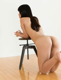 Youthfull bare Asian with bare feet providing a footjob to some successful man