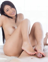 Nasty Asian bombshell gives a sexy footjob to get toes drenched in sticky cum
