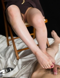 Japanese woman in suit leisurely takes off to the toes to give a scorching footjob