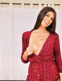 Glamorou girlfriend Olivia Lua poses half nude displaying her diminutive knockers