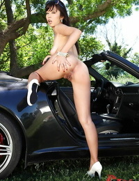 Asian bombshell in sunglasses spreading her vagina with her frigs outdoor