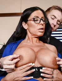 Mature brown-haired in glasses Simone Garza entrances a man with her big tits
