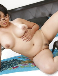 Curvaceous asian babe in glasses Mika Suntan disrobing and playing with her big tits