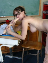 Nerdy mature schoolteacher Angelika whips out huge fake penis in classroom