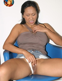 Middle-aged Asian lady Kitty Langdon deep throats off a ebony dick at a gloryhole