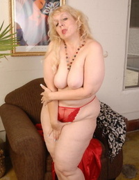 Sexy granny Anne undressing her crimson sundress in a leisurely way!