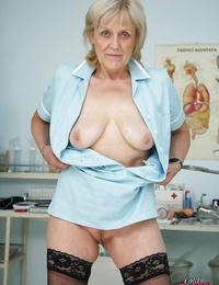 Blonde granny in nurse uniform getting horny sitting on gynochair