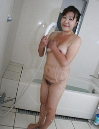 Horny asian granny with puffy tits and S/M coochie taking shower