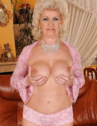 Lusty granny showcasing her fat jugs and fuzzy pouch coated with panties