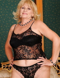 Curvaceous granny in tights stripping off her suit and lingerie