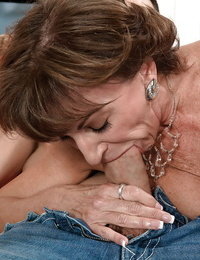 Old woman with necklace Sydni Lane deep-throats young penis and receives cumshot