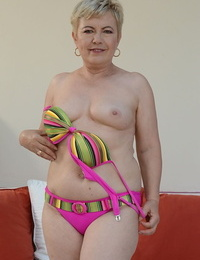 Light-haired granny in colorful lingerie Ursula Grande fingering her cooter