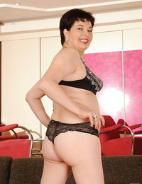 Buxomy brunette granny with yam-sized booty undressing off her dress and lingerie